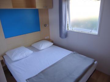 Camping les Grissotières location mobil-home Jhon-Fenn chambre 1 un lit 140/190