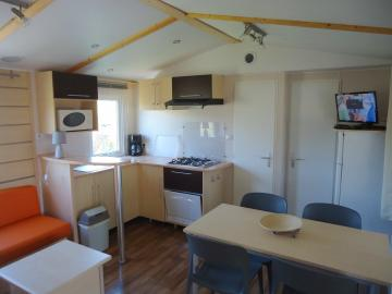 Location mobil home Camping Grissotières coin repas