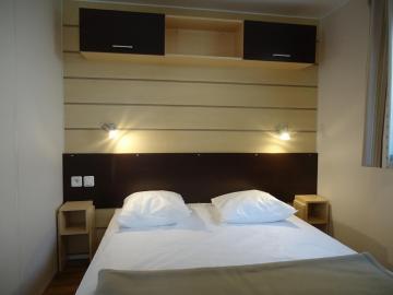 Camping les Grissotières location Mobil home chambre 1 un lit de  140/190