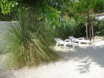Camping les Grissotières location maison Oléronaise  jardin